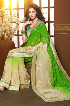 Cream and green chiffon saree with green art silk blouse.  Embellished with embroidered and zari.  Saree comes with v neck blouse.  It is perfect for casual wear, festival wear, party wear and wedding wear.  Andaaz Fashion is the most popular designer wear online ethnic shop brands.  http://www.andaazfashion.us/womens/sarees/view/new-arrival-saree