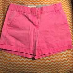 JCrew Pink Chino Short in Bright Pink These are the best shorts! I own them in a variety of colors and sizes. These are the perfect length (flattering but not too much skin) if you feel like they're too long you can also roll them up for another cute look. Decided a 4 fit better after wearing them once. J. Crew Shorts
