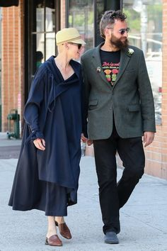 """Tilda Swinton & partner Sandro Kopp out and about in NYC. """"Tilda will dress however the hell she wants to, and that will include repurposed tents and the kind of shoes you buy at a street bazaar. ...she clearly doesn't give a fuck what anyone else thinks. [and] she's winning at life, which is the best way to silence any criticisms about her style choices."""" Tom & Lorenzo"""