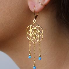 Flower of Life earrings with blue Swarovski opals on dangling chains by MaYaJEWELRYDESIGN on Etsy https://www.etsy.com/listing/238742709/flower-of-life-earrings-with-blue