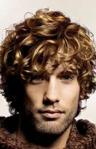 Man's brown curly hair with golden highlights hairstyle