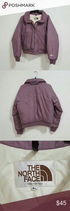 """The North Face Lavender Bomber Jacket Size L Super cute lavender The North Face puff bomber jacket  - Excellent Condition (Very light signs of use, nothing noticeable) - Full zip & button up - 2 outer zip pockets  - 1 inner zip pocket - Size L  Measurements (inches):  Chest - 36"""" Pit to pit - 20"""" Back length - 20.5"""" The North Face Jackets & Coats Puffers"""