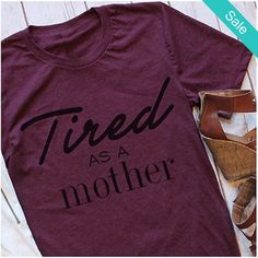 """Women's Fun Graphic Printed Burgundy """"Tired as a Mother"""" Crewneck T-Shirt Top - SKU:6188260Material: CottonFabric Type: JerseySleeve Length: Short Fit: Smaller than normal, order up a size Please allow 2-5 weeks for shipping/processing time. - On Sale for $22.00 (was $34.00)"""