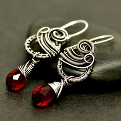 These adorable earrings only measure 3.5 cm in length, excluding the ear wire, and wear light and comfortably. Silver-filled wire has been hand woven and coiled to create lovely mirror swirls and c...