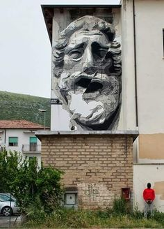 Ino, lower right, with his work in Fondi, Italy, 5/15 (LP)