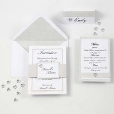 An invitation made from a greeting card decorated with silver design paper and white textured paper with printed text. Decorated with a matching waistband in the same materials and a heartshaped rhinestone sticker. The envelope is lined with glitter paper Anna Martin, Menu Cards, Place Card Holders, Paper Texture, Invitations, Envelope, Greeting Cards, Personalized Items, Prints