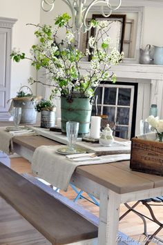 Summertime table setting. Ice cream churn with flowering branches.