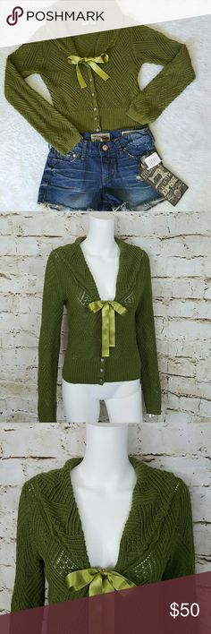 """Anthropologie HWR Beautiful sweater Gorgeous Anthro sweater!  Pretty satin ribbon tie in front, lovely silver tone decorative buttons, silver metallic thread weaved through the sweater ribbed hem and sleeves 18"""" across from armpit to armpit and 22"""" long from shoulder to hem this sweater has some stretch to it Anthropologie Sweaters"""