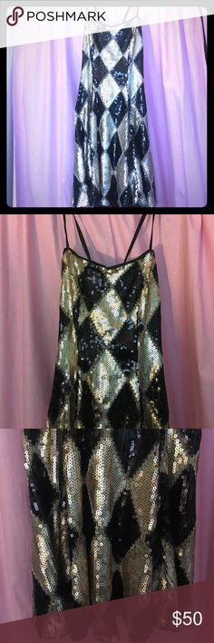 NWT Suicide Squad Harley Quinn Club Dress I bought this at hot topic but just never wear it. It is a replica of Harley's gold & black diamond dress in the club scene of Suicide Squad. It is new with tags! Hot Topic Dresses Mini