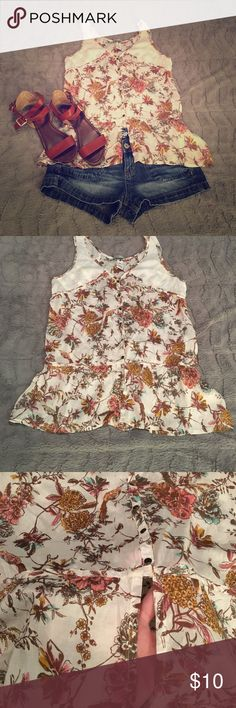 Billabong, Cream & Floral Tank Top Beautiful! This tank top is very feminine and sexy it features cream fabric with lace on the upper bodice. It snaps down the front to just above the belly button where the fabric goes down lower there is a slight opening in the front so you can see the belly button, really cute of you have it pierced. In excellent condition. Billabong Tops Tank Tops