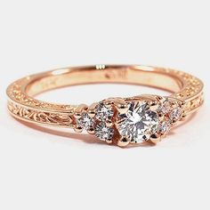 14K Rose Gold Adorned Trio Diamond Ring // Set with a 0.31 Carat, Round, Super Ideal Cut, F Color, VVS1 Clarity Diamond #BrilliantEarth