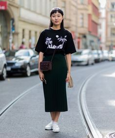 You can totally rock your graphic tees in fashion outfits!