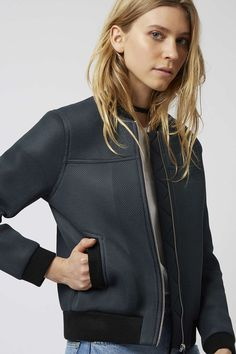 Airtex is the textile of choice this season. This structured bomber jacket combines a trending tough texture with boxy edge. With contrasting chunky silver zip detailing to the front and pockets for added practicality, pair pack with a crop and denim for sports-luxe cool. #Topshop