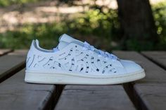 the latest d3243 e98a1 adidas Stan Smith Cutout White BB5149. The adidas Stan Smith Cutout White  features geometric patterns