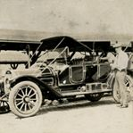 Walter purchased a Locomobile for $5,000 at the 1908 Chicago autoshow. He convinced a bank friend loan him the money and spent months disassembling and reassembling the car. The first time he drove it was into a ditch; he had to be pulled out by horse and buggy. He is shown with his brother, Ed, with a new family car in 1911.