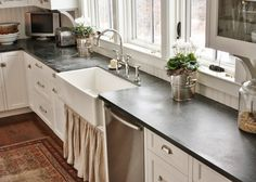 14 Soapstone Countertops to Inspire Your Kitchen Design Soapstone is a low maintenance option for kitchen countertops. See some of our favorite ways to incorporate the material into your kitchen. Types Of Kitchen Countertops, Slate Countertop, Soapstone Counters, Soapstone Kitchen, Countertop Materials, White Kitchen Cabinets, Quartz Countertops, Kitchen Island, Modern Kitchens