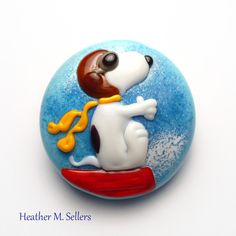 Fly Away: a Snoopy inspired lampwork glass bead by Heather Sellers. #peanuts #snoopy #lampwork