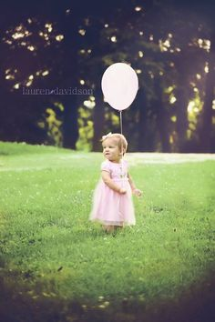 Vintage style one year birthday photo with balloon. 1 year girl photos. Lauren Davidson Photography.
