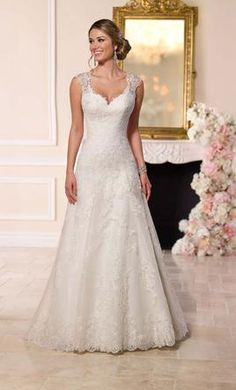 Stella York 6219: buy this dress for a fraction of the salon price on PreOwnedWeddingDresses.com