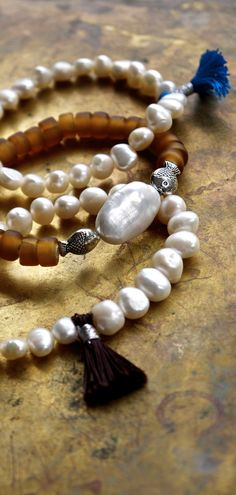 Fabulous bohemian style freshwater pearl and tribal glass bead bracelet stack with a huge baroque pearl and tiny tassels.....at The Pillow Book