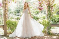Style 9661 - Ivory / Cashmere tulle bridal ball gown with delicate floral embroidery throughout the skirt. V-neck ballerina bodice of sheer, draped tulle over lace with double spaghetti straps.