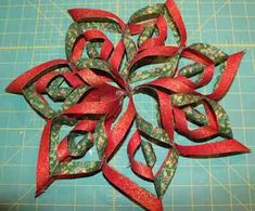 Free Fabric Snowflake Tutorial - Make a no-sew Fabric Snowflake. Step-by-step photos and a video tutorial show you how to make this fabric snowflake. Decorate for the holidays with these beautiful fabric snowflakes! Folded Fabric Ornaments, Quilted Christmas Ornaments, Christmas Origami, Christmas Sewing, Christmas Snowflakes, Christmas Projects, Christmas Crafts, Christmas Ideas, Snowflake Ornaments