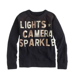 lights camera sparkle sweater