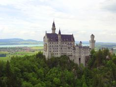 Neuschwanstein Castle, Bavaria, Germany. View from Mary's Bridge, a castle, up in the lower Alps, reaching for the clouds.