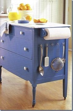 Repurposed dresser for kitchen.  Could also do the same thing as a garden bench with shelves instead of the large drawers.
