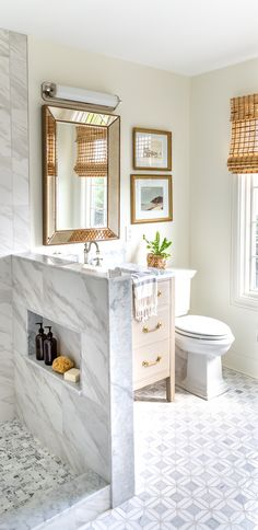 Small guest bathroom renovation featuring gorgeous marble mosaic tile, large format porcelain tile, a warm wood vanity, polished nickel finishes, and vintage accents. Amazing transformation! Marble Mosaic, Mosaic Tiles, Amazing Transformations, Wood Vanity, Porcelain Tile, Polished Nickel, Home Renovation, Wood Projects, Bathrooms