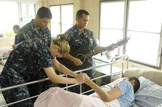 Lt. Anthony Baker, the command chaplain assigned to the U.S. 7th Fleet flagship USS Blue Ridge (LCC 19), plays a guitar during a community service event at the Camillian Social Center in Rayong, Thailand. (U.S. Navy photo by Mass Communication Specialist 3rd Class Cale Hatch/Released)