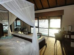 our suite booked for the honeymoon! Four Seasons Resort Maldives at Kuda Huraa: sunset water bungalow