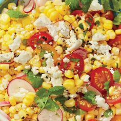 Easy Street Corn Salad comes together in a snap. Simply combine the ingredients with a dash of olive oil and sprinkle with cheese. Now that's summer siding made simple!