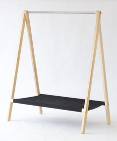 Clothes rack by KROFT. Made from solid wood, canvas and metal. This is the perfect accessory for any home or retail store. Tags: Modern Clothing Rack, Modern Clothes Rack, Retail Design, Pop Up Store, Retail Fixture, Clothing Storage