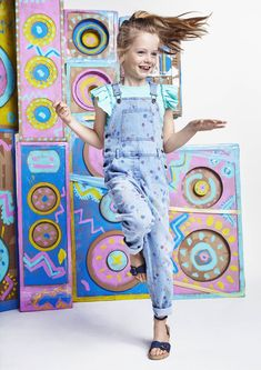 Denim dungarees get an arty makeover with multicolour polka dot paint splats in the Stella McCartney Kids SS16 collection.
