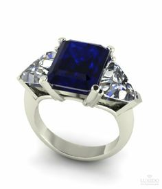 Gorgeous octagonal blue sapphire sided by two trillion cut diamonds. Choose your gemstone and create your own unique jewel From Luxedogems.com