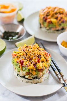 These Spicy Shrimp Stacks with Mango Salsa are a fun twist on a spicy California roll, topped with a quick guacamole and drizzled with Bang Bang sauce!