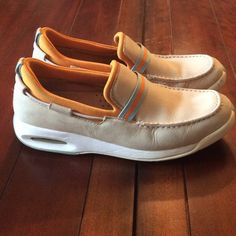 Cole Haan men's deck or boat shoes Beautiful fawn neutral soft calf leather with aqua and orange details. Has Nike Air soles. Very good condition. Cole Haan Shoes Flats & Loafers