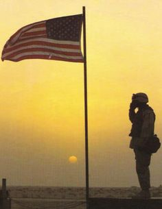 Soldier Salutes USA Flag Desert Warzone