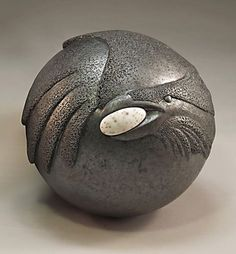 """Artists Ken and Pat Larson """"Raven with egg"""" Ceramic We've worked together since 1975, as a collaborative team since the mid 1980's. Our collaboration involves no assistants and no set pattern for the interplay. Each of us works on what we are best at for every piece."""