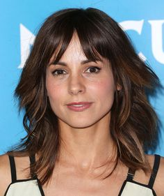 Stephanie Szostak sported windblown layers and wispy bangs during NBCUniversal's Summer Press Day.