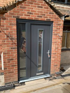 Solid Core Doors supplied and fitted from just including VAT with a ultion lock as standard. Porch Doors Uk, Porch And Foyer, Porch Uk, House Front Porch, Front Porch Design, Front Porches, Composite Front Doors Uk, Grey Front Doors, Brick Porch