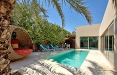 Pool Villa. Desert Palm, Dubai. © Per AQUUM  |  I recently went to a spa with the same chairs....LOVE them!!