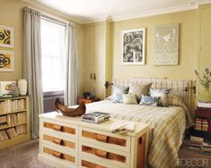 In a London master bedroom by Allegra Hicks, a dresser at just the right height provides extra storage space.