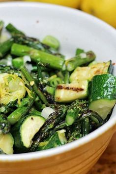Fresh asparagus and zucchini are grilled, then tossed in a lemon and basil sauce with tangy garlic, and scallions.