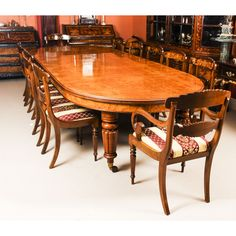 A lovely dining set comprising an antique Victorian pollard oak extending dining table and a bespoke set of twelve dining chairs.