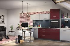 Une cuisine rouge et blanche moderne et contemporaine, ouverte avec un bar à l'américaine.