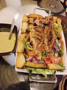 Fried snapper with salad, yams,  avocado, tomatoes,  onions and homemade vinaigrette