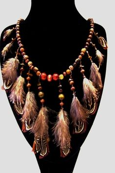 'brown feather necklace, stone chips, Native American In' is going up for auction at 11am Sun, Nov 18 with a starting bid of $25.