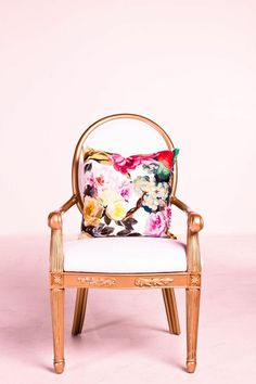 @RoxyTeOwens // SocietySocial // The Duchess // white and gold chair // floral pillow // photography by Lawrence Te